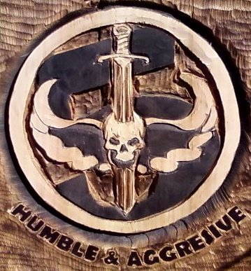 2011-08-18-HumbleSeal-Chainsaw-Carved-Seal-Swords-1.jpg