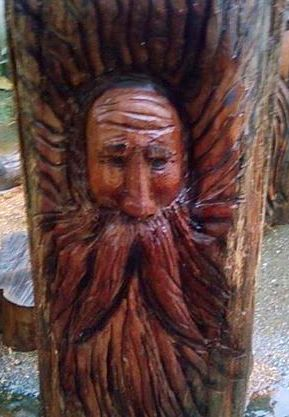 2012-07-20-Man-Chainsaw-Carved-Face-1.jpg