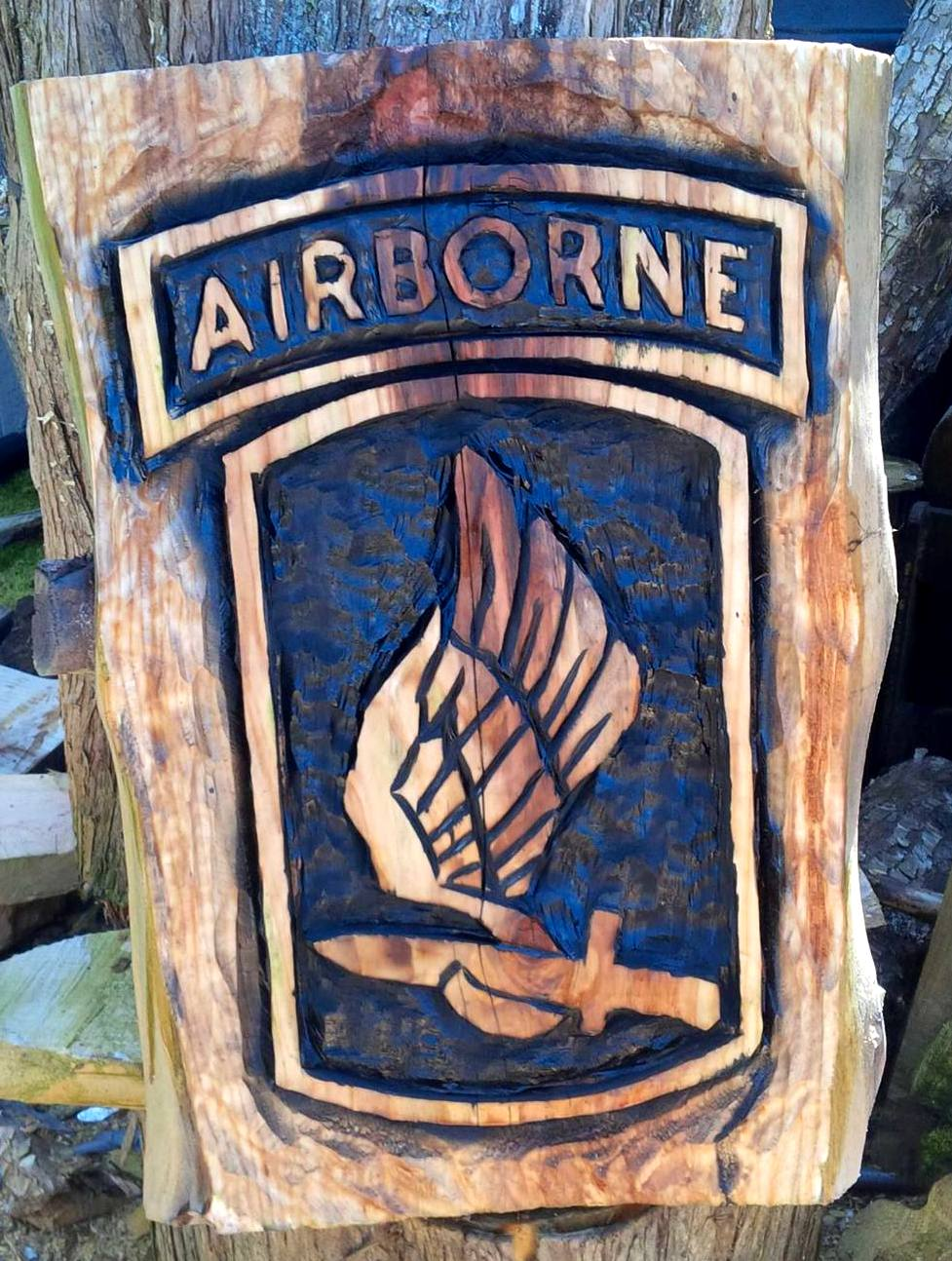 2014-05-13-Airborne-Chainsaw-Carved-Sign-1.jpg